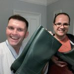 Gary and Alan Burgess receiving their wellies from Susie